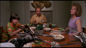 In Edward Scissorhands, the title character looks at his new family from across the dinner table.